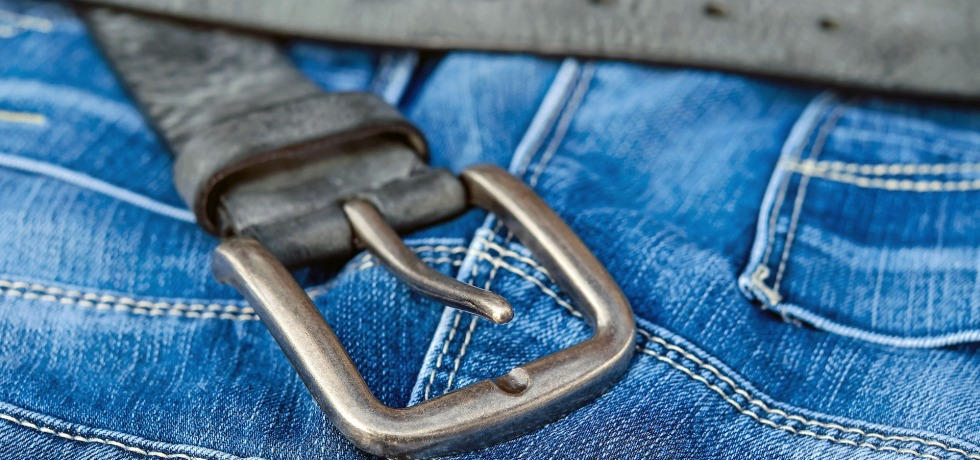 Blue denim jeans with a black belt and buckle.