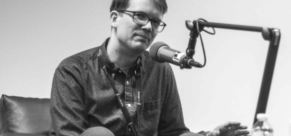 Hank Green behind microphone.