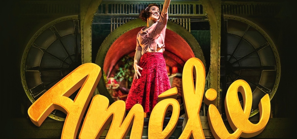 Promotional image for Amelie the Musical, showing Amelie in a pink shirt and red dress with her left arm reaching upwards. Below her is the text Amelie in a giant yellow typeface.