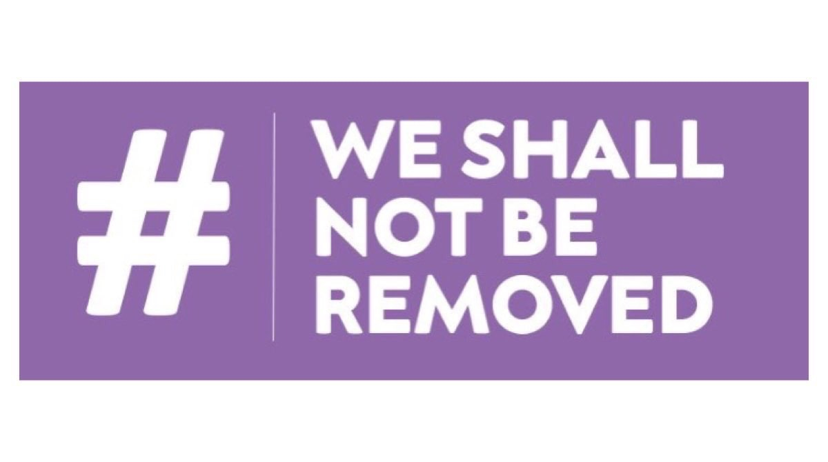 Purple logo which has a hashtag on the left, and the words 'We Shall Not Be Removed' on the right.