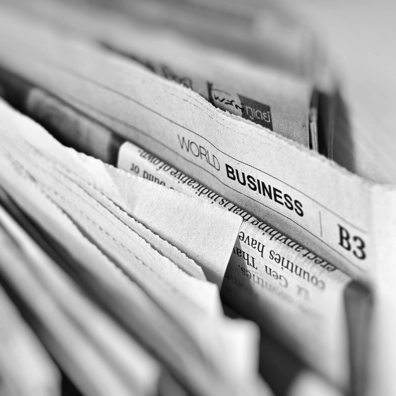 Newspaper bundle in black and white.