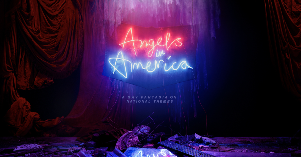 Neon text reads 'Angels in America'. Below this is further text which reads, 'A gay fantasia on national themes'. There is rubble on the ground and red curtains on either side of the sign.