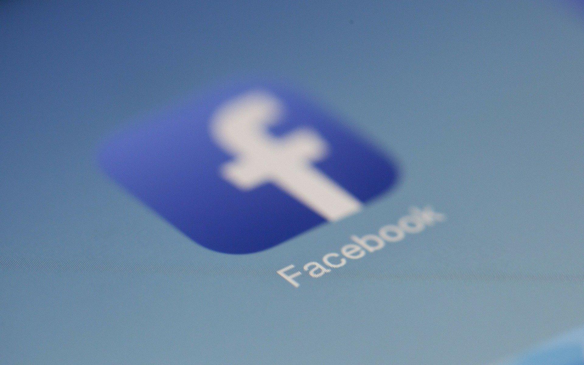 Blue Facebook app logo on a phone screen.