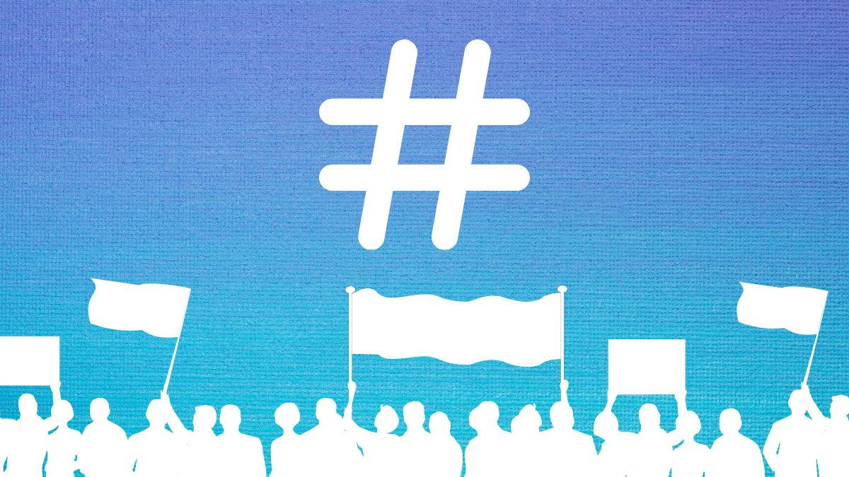 A blue gradient background. Centred at the top is a hashtag. Underneath, at the bottom of the image is a row of people in a crowd, some holding flags and banners.