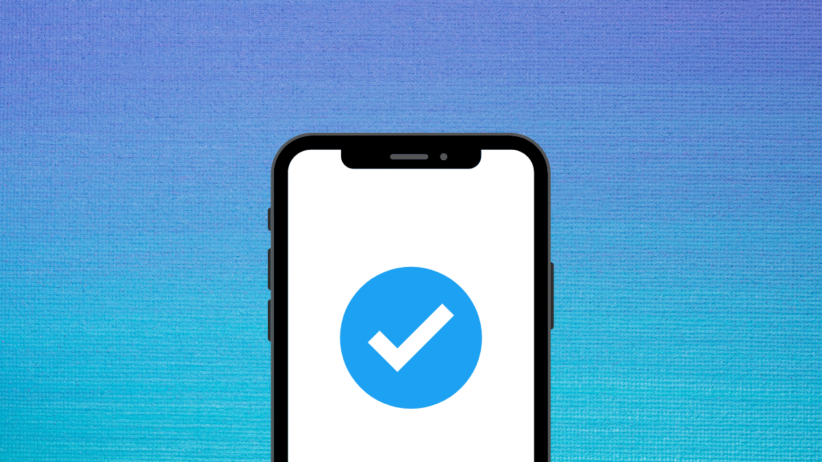 iPhone with a blue verified tick on a white background. In the background behind the phone is a dark blue to light blue gradient.